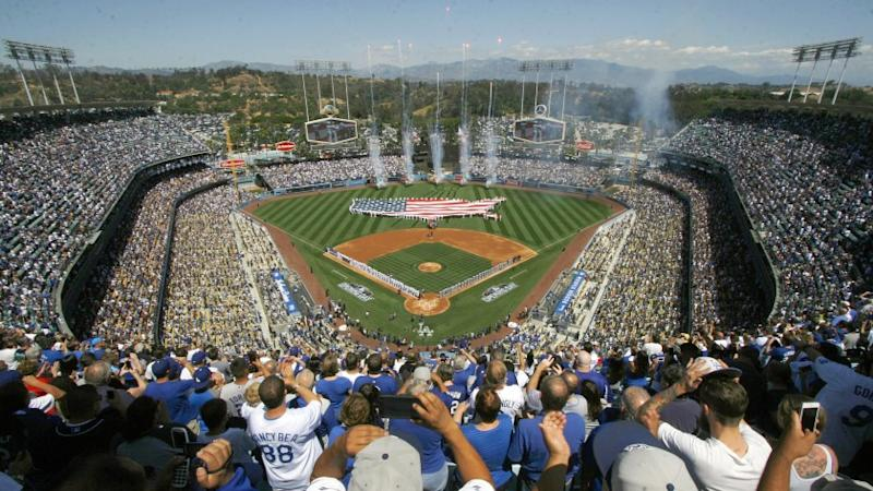 Fans cheer during opening day ceremonies before the start of Monday's game between the Dodgers and San Diego Padres at Dodger Stadium.