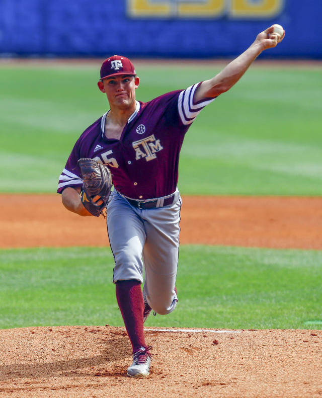 Texas A&M pitcher Asa Lacy (35) throws a pitch during the first inning of a Southeastern Conference Tournament NCAA college baseball game against Georgia, Wednesday, May 23, 2018, in Hoover, Ala. (AP Photo/Butch Dill)