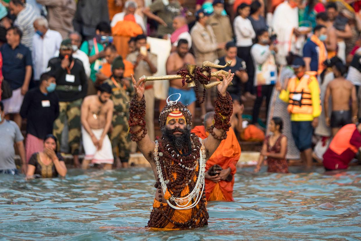 TOPSHOT - A Sadhu bathes in the Ganges river during the ongoing religious Kumbh Mela festival in Haridwar on April 12, 2021. (Photo by Xavier GALIANA / AFP) (Photo by XAVIER GALIANA/AFP via Getty Images)