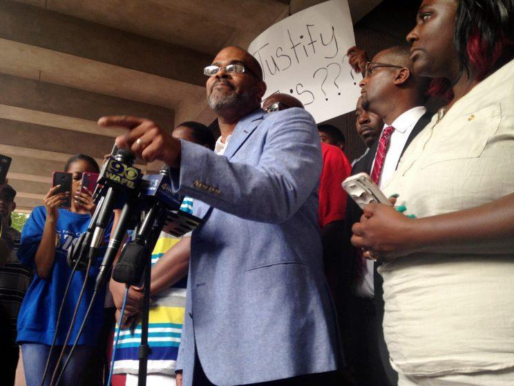 Michael McClanahan, head of the NAACP in Baton Rouge, speaks to reporters outside City Hall in Baton Rouge, La., Wednesday, July 6, 2016. (Photo: Mike Kunzelman/AP)