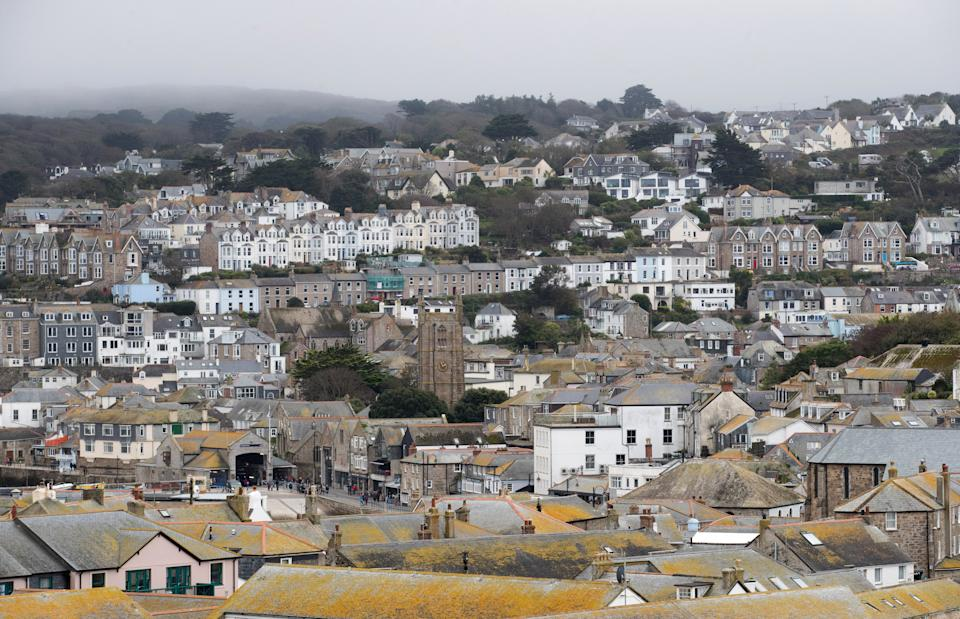 ST IVES, ENGLAND - OCTOBER 10:  Properties in the town of St Ives, which has introduced measures to limit the number of second homes, are seen in St Ives on October 10, 2017 in Cornwall, England. Following on from St Ives the picturesque Cornish coastal fishing village of Mevagissey has also submitted plans to Cornwall Council to block outsiders buying new-builds to use as holiday homes in an attempt to give local first-time buyers better chances of getting on the property ladder rather than being outbid by wealthy second home owners. The village's Neighbourhood Development Plan has highlighted that currently twenty six per cent of the homes in Mevagissey are holiday homes with average prices, according to Rightmove, of £299,587, nearly £50,000 more than the Cornish average of £250,000, and 20 times the local average wage of £15,458. It also noted that although since 1930 the buildings in the village have more than doubled, the permanent population of Mevagissey has actually fallen over the last 200 years. If the plans are approved they will be returned to the village to be voted on in a referendum and will follow attempts by other communities in Cornwall which have introduced new-build bans including most notably St Ives.  (Photo by Matt Cardy/Getty Images)