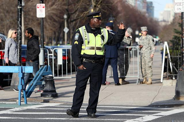 BOSTON, MA - APRIL 15: The outter perimeter near Massachusetts Avenue and Newbury Street is secured by police after two explosive devices detonated at the finish line of the 117th Boston Marathon on April 15, 2013 in Boston, Massachusetts. Two people are confirmed dead and at least 23 injured after two explosions went off near the finish line to the marathon. (Photo by Alex Trautwig/Getty Images)