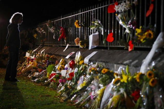 Mourners pay their respects at a makeshift memorial near the Masjid Al Noor mosque in Christchurch, New Zealand, Saturday, March 16, 2019. New Zealand's stricken residents reached out to Muslims in their neighborhoods and around the country, to show kindness to a community in pain as a 28-year-old white supremacist stood silently before a judge, accused in mass shootings at two mosques that left dozens of people dead. (AP Photo/Vincent Thian)
