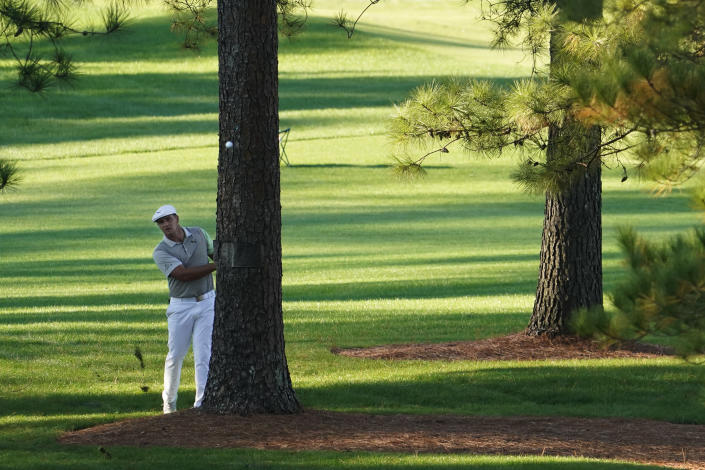 Bryson DeChambeau hits out of the rough on the seventh hole during the second round of the Masters golf tournament Friday, Nov. 13, 2020, in Augusta, Ga. (AP Photo/David J. Phillip)