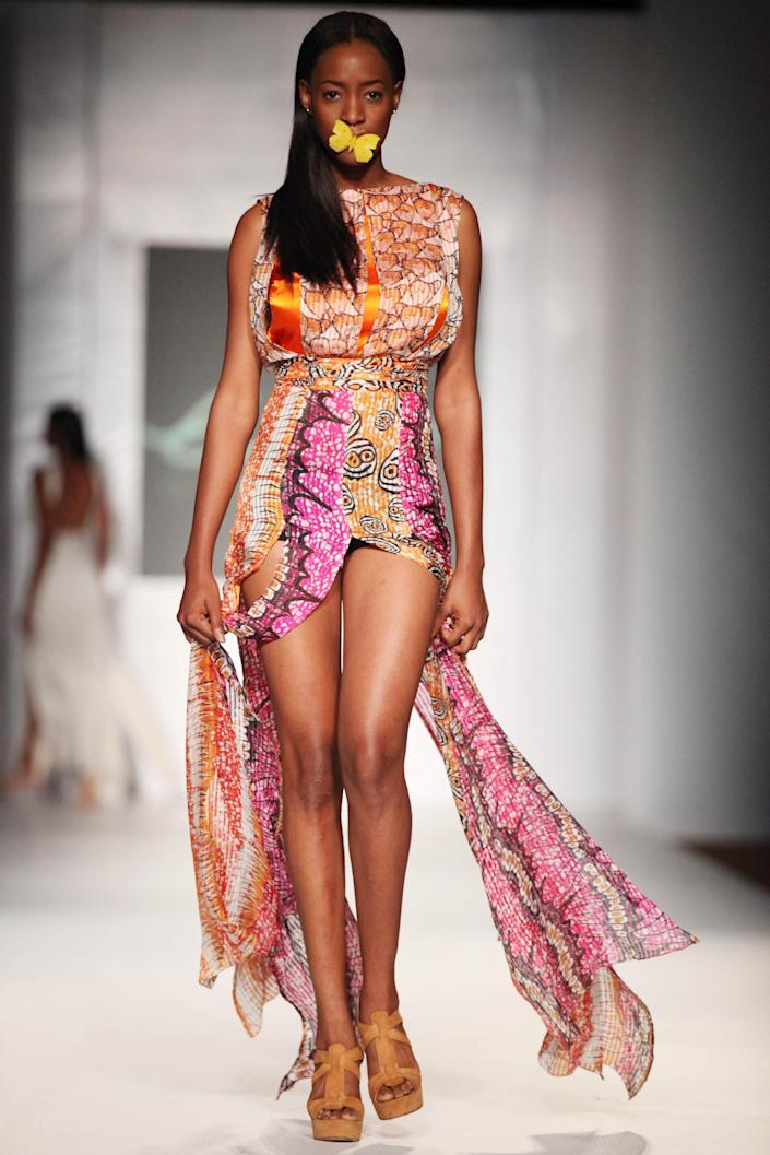 A model shows a creation by designer Eki Orleans during the MTN Fashion and Design Week in Lagos, Nigeria, Friday, Oct. 26, 2012. (AP Photo/Sunday Alamba)