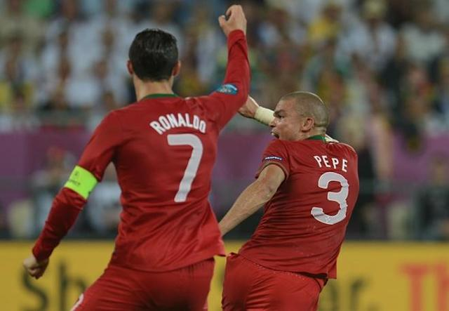 Portuguese defender Pepe (R) gestures during the Euro 2012 championships football match Germany vs Portugal on June 9, 2012 at the Arena Lviv. AFP PHOTO / PATRIK STOLLARZPATRIK STOLLARZ/AFP/GettyImages