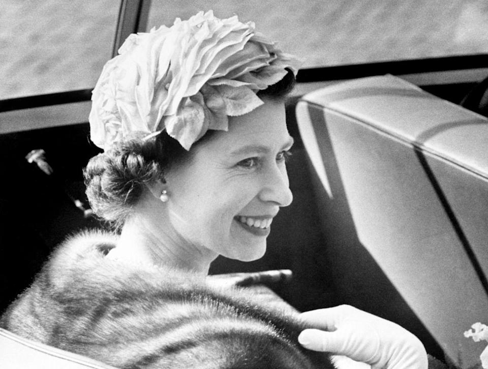<p>During a state visit to Denmark, the Queen smiles as she arrives at Copenhagen Town Hall in an open top car. (PA) </p>