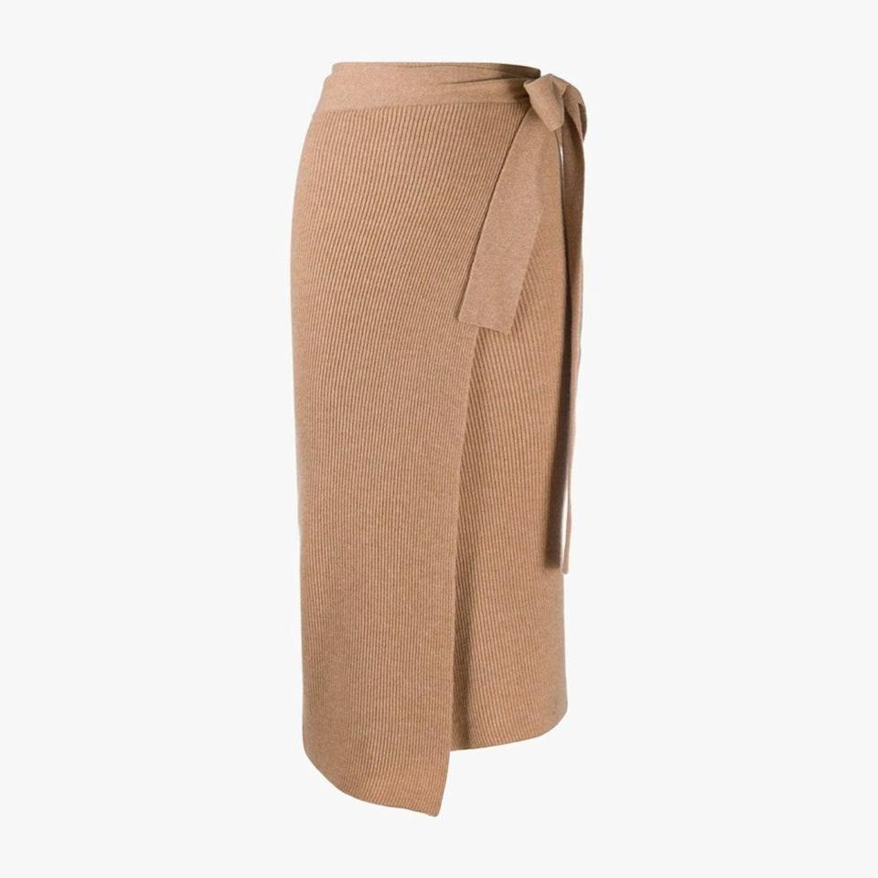 """$345, CASMERE IN LOVE. <a href=""""https://www.cashmereinlove.com/collections/skirts/products/lucy-knitted-wrap-skirt-camel"""" rel=""""nofollow noopener"""" target=""""_blank"""" data-ylk=""""slk:Get it now!"""" class=""""link rapid-noclick-resp"""">Get it now!</a>"""