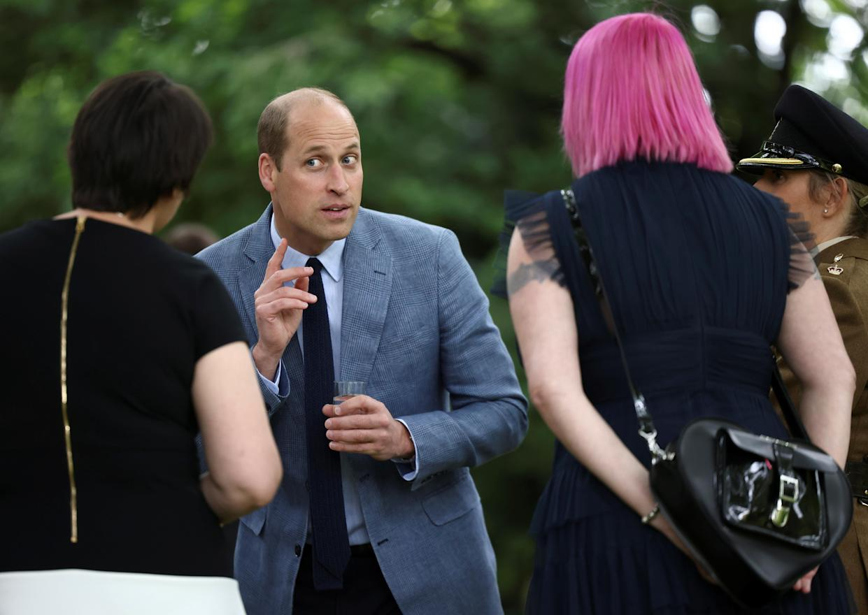 The Duke of Cambridge, in his role as Joint Patron of NHS Charities Together, speaks to guests during a 'Big Tea' for NHS staff at Buckingham Palace in London, to mark the 73rd birthday of the NHS. Picture date: Monday July 5, 2021.