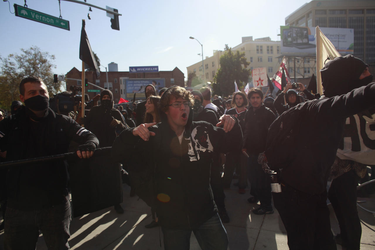 OAKLAND, CA - NOVEMBER 2:  Anarchists smash the windows of a supermarket during an Occupy demonstration November 2, 2011 in Oakland, California. The group called for a general strike Wednesday, and planned to march on the city's port later in the day.(Photo by Eric Thayer/Getty Images)