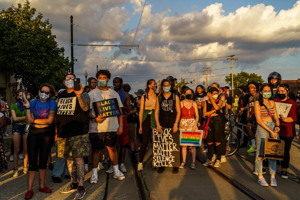 Protesters stand on a road during a march against the shooting of Jacob Blake in Kenosha, Wisconsin on August 27, 2020. (Photo by Kerem Yucel/AFP via Getty Images)
