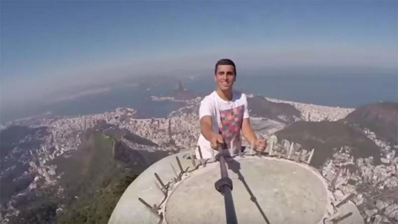 Epic Selfie On Top Of Christ The Redeemer In Rio - Guy takes epic selfie top christ redeemer statue brazil