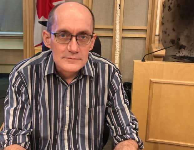Nunavut's chief public health officer, Dr. Michael Patterson, said starting Nov. 1, out-of-territory workers who are not fully vaccinated will only have two ways to get an exemption from isolating for two weeks before traveling north: a medical exemption from a doctor, or a role in helping to fix 'sudden and severe damage to critical infrastructure.' (Jacqueline McKay/CBC - image credit)
