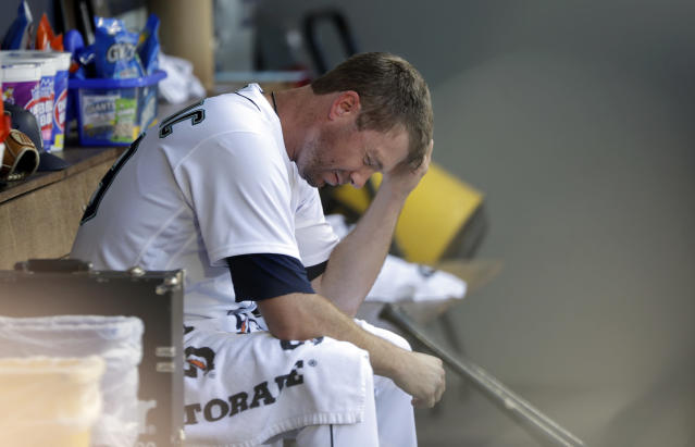 Seattle Mariners starting pitcher Wade LeBlanc sits in the dugout after being relieved in the fifth inning of a baseball game against the Houston Astros, Wednesday, Aug. 1, 2018, in Seattle. (AP Photo/Elaine Thompson)