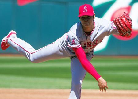 Apr 1, 2018; Oakland, CA, USA; Los Angeles Angels starting pitcher Shohei Ohtani (17) after the release on a pitch against the Oakland Athletics during the third inning at Oakland Coliseum.  Kelley L Cox-USA TODAY Sports