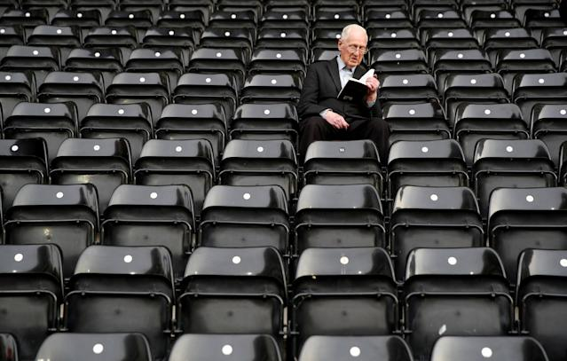 "Soccer Football - League Two Play Off Semi Final Second Leg - Notts County vs Coventry City - Meadow Lane, Nottingham, Britain - May 18, 2018 General view of a fan reading a book in the ground before the match Action Images/Carl Recine EDITORIAL USE ONLY. No use with unauthorized audio, video, data, fixture lists, club/league logos or ""live"" services. Online in-match use limited to 75 images, no video emulation. No use in betting, games or single club/league/player publications. Please contact your account representative for further details. TPX IMAGES OF THE DAY"