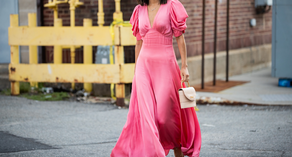 street style influencer walking down street in pink maxi dress with puffy sleeves