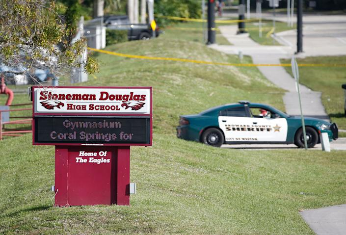 Law enforcement officers block off the entrance to Marjory Stoneman Douglas High School in Parkland, Florida, on Feb. 15, 2018, after a mass shooting left 17 people dead. (Photo: ASSOCIATED PRESS)
