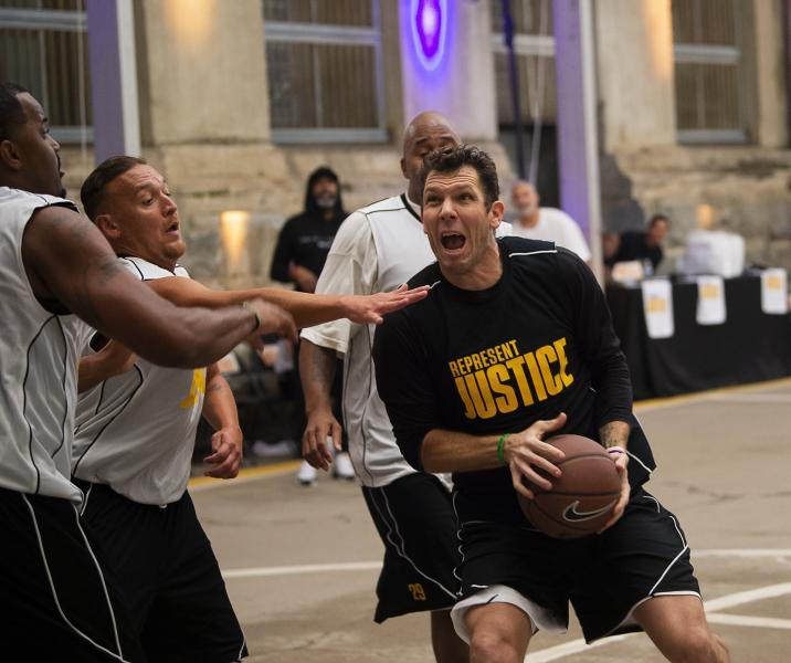 In this Thursday, Dec. 12, 2019 photo, Sacramento Kings coach Luke Walton plays basketball with a team of inmates as the Kings and the Represent Justice Campaign host a game at Folsom State Prison in Folsom, Calif. (Paul Kitagaki Jr./The Sacramento Bee via AP, Pool0