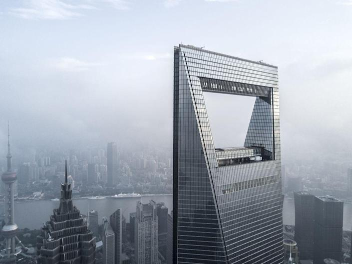 <p><strong>Location:</strong> Shanghai, China</p><p><strong>Height:</strong> 1,622 feet</p><p><strong>Completion Date:</strong> 2008</p><p>You can buy bottle openers shaped like this building thanks to the open space at the very top that resembles the tool we use to crack into a cold one. The little souvenirs can be found within the observation deck gift shop, one of 101 floors within the massive structure. The building is used for several purposes and includes offices, hotel rooms, conference rooms, and even shopping on the ground floor.<br></p>
