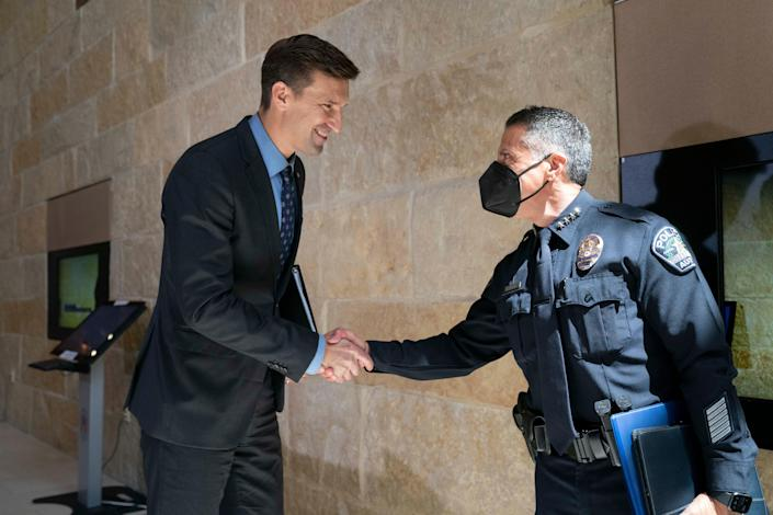 Austin City Manager Spencer Cronk shakes hands with Joseph Chacon after naming him Austin's next police chief after he served in an interim role for several months.