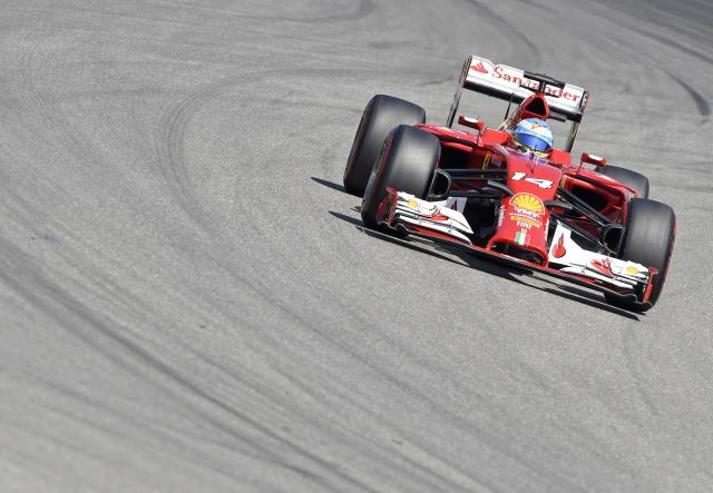 Ferrari driver Fernando Alonso of Spain speeds during the third free practice session at the German Formula One Grand Prix in Hockenheim, Germany, Saturday, July 19, 2014. The German Grand Prix will be held on Sunday, July 20, 2014. (AP Photo/Jens Meyer)