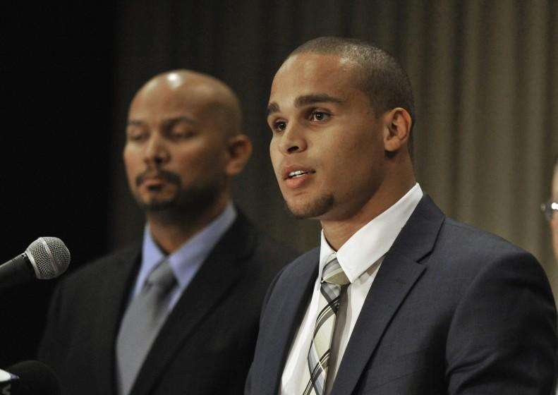 Northwestern quarterback Kain Colter, right, speaks while College Athletes Players Association President Ramogi Huma listens during a news conference in Chicago. In a landmark ruling Wednesday, a federal agency gave football players at Northwestern University the green light to unionize.