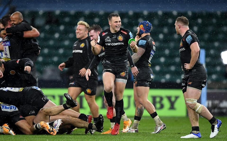 Joe Simmonds of Exeter Chiefs celebrates victory with Sam Simmonds after the Gallagher Premiership Rugby final match between Exeter Chiefs and Wasps - GETTY IMAGES