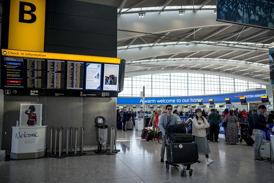 Passengers queue to check-in for their flights at Heathrow Airport's Terminal 5 in west London, on September 13, 2019. - British Airways has cancelled all its scheduled UK flights for September 27, when company pilots will again strike in a long-running row over pay. (Photo by Tolga Akmen / AFP)        (Photo credit should read TOLGA AKMEN/AFP/Getty Images)