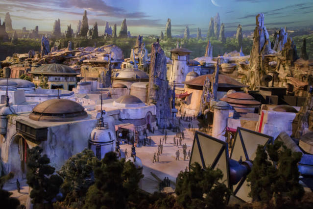 <p>A full-sized TIE dominates the far side of <em>Galaxy's Edge</em>. We also know that there are two giant AT-ATs being built, but they weren't visible on the model… presumably they're hidden somewhere, possibly in the middle section. (Disney Parks/Joshua Sudock) </p>