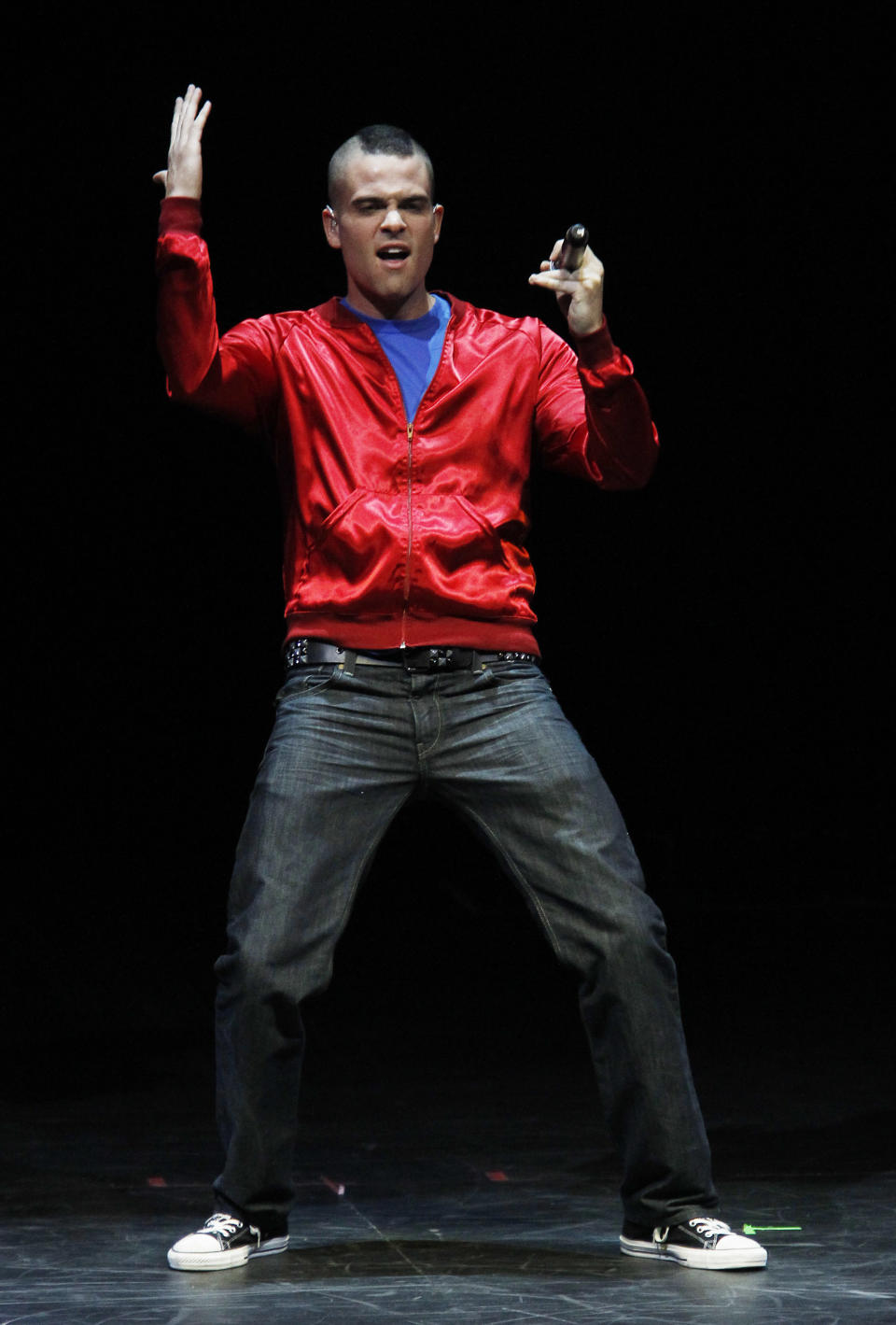 """Mark Salling, a cast member of the popular television show """"Glee"""",  performs during a concert to kickoff a national """"Glee"""" tour at the Dodge Theatre Saturday, May 15, 2010, in Phoenix. (AP Photo/Ross D. Franklin)"""