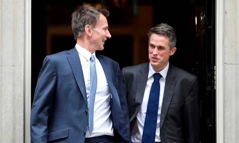 Jeremy Hunt and Gavin Williamson leaving Downing Street. Both have denied being the leaker.