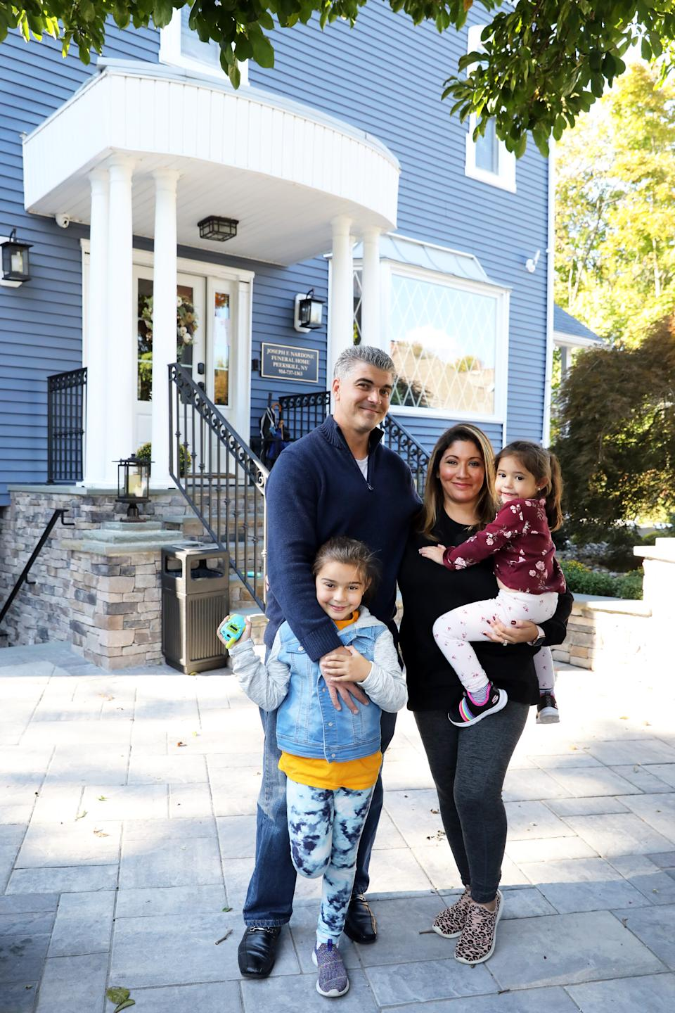 Jason and Leslie Chiaramonte with daughters Brooklyn, 6, and Phoenix, 3, outside the Joseph F. Nardone Funeral Home in Peekskill, where Mr. Chiaramonte is the funeral director, Oct. 9, 2020.