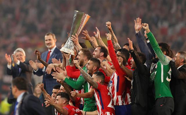 Soccer Football - Europa League Final - Olympique de Marseille vs Atletico Madrid - Groupama Stadium, Lyon, France - May 16, 2018 Atletico Madrid celebrate with the trophy after winning the Europa League REUTERS/John Sibley