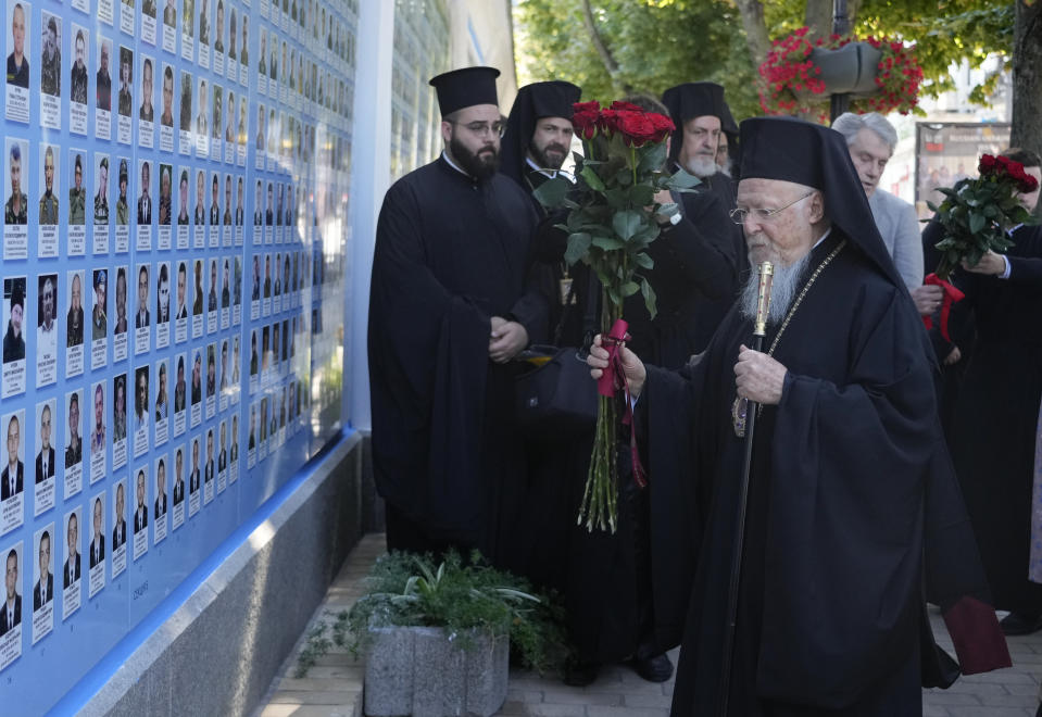 Ecumenical Patriarch Bartholomew I, lays flowers at the Memorial Wall of Fallen Defenders of Ukraine in Russian-Ukrainian War in Kyiv, Ukraine, Saturday, Aug. 21, 2021. Bartholomew I, arrived to Kyiv to mark the 30th anniversary of Ukraine's independence that is celebrated on Aug. 24. (AP Photo/Efrem Lukatsky)