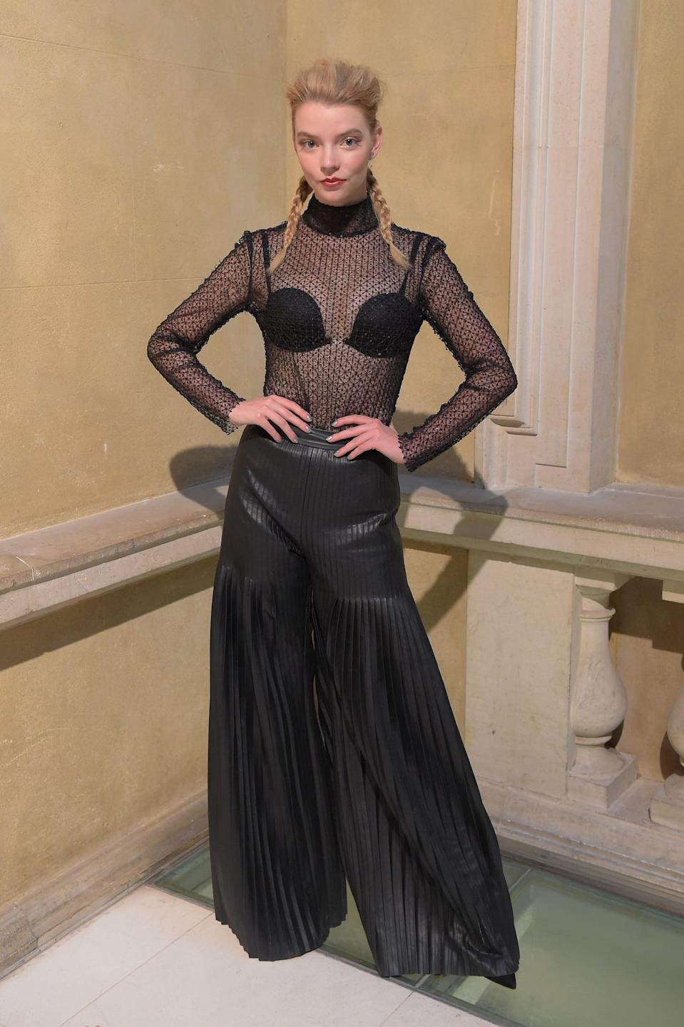 <p>Anya wore a sheer black top and wide-leg, pleated trousers to Huishan Zhang's front row.</p>
