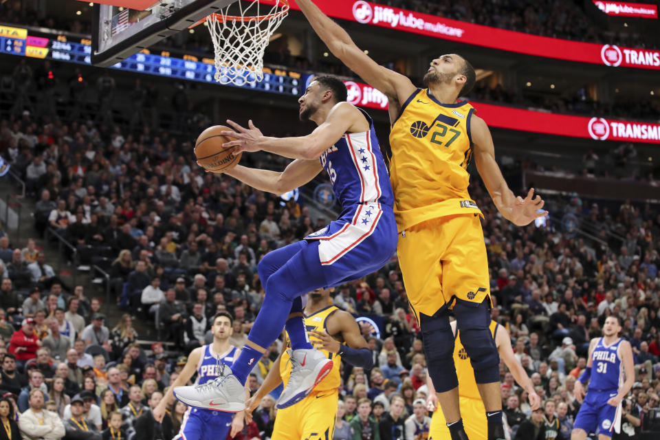 Philadelphia 76ers guard Ben Simmons (25) gets past Utah Jazz center Rudy Gobert (27) and looks to the basket during the second quarter of an NBA basketball game Thursday, Dec. 27, 2018, in Salt Lake City. (AP Photo/Chris Nicoll)