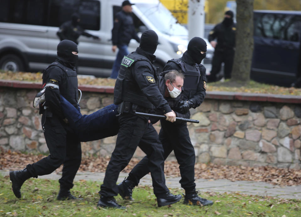 Police detain a man during an opposition rally to protest the official presidential election results in Minsk, Belarus, Sunday, Nov. 1, 2020. Nearly three months after Belarus' authoritarian president's re-election to a sixth term in a vote widely seen as rigged, the continuing rallies have cast an unprecedented challenge to his 26-year rule. (AP Photo)