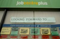 Job adverts are seen in the window of a job centre following the outbreak of the coronavirus disease (COVID-19), in Manchester