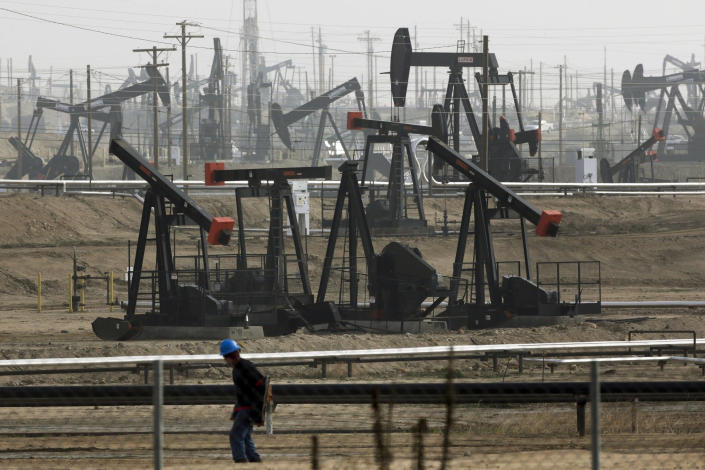 FILE - In this Jan. 16, 2015, file photo, pumpjacks are seen operating in Bakersfield, Calif. On Friday, April 23, 2021, California Gov. Gavin Newsom announced he would halt all new fracking permits in the state by January 2024. He also ordered state regulators to plan for halting all oil extraction in the state by 2045. (AP Photo/Jae C. Hong, File)