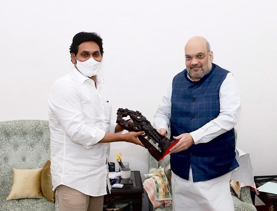 Jagan Mohan Reddy gifts and idol to Home Minister Amit Shah in New Delhi.