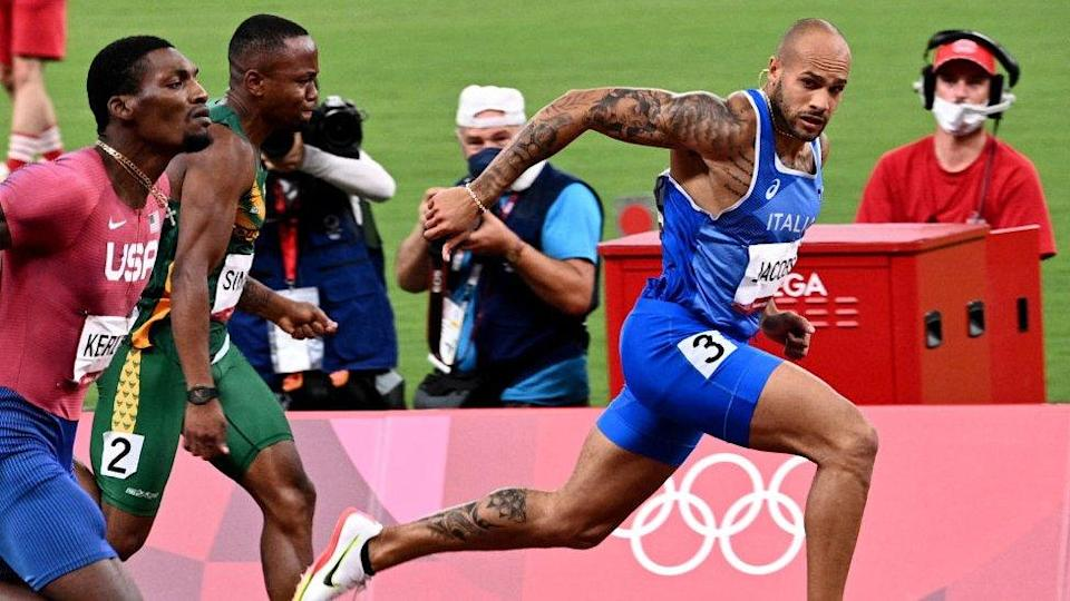 Italy's Lamont Marcell Jacobs competes in the men's 100m final