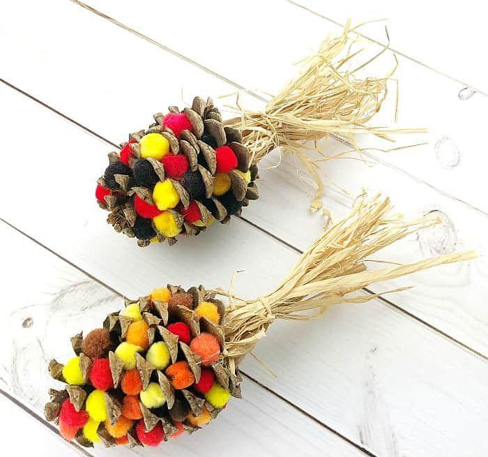 """<p>If you need a fall craft for your table, a few pom poms and some raffia or crepe paper transforms regular pinecones into flint corn. It's a perfect way to add some color to a centerpiece.</p><p><em><a href=""""https://buggyandbuddy.com/pinecone-indian-corn-craft-for-thanksgiving/"""" rel=""""nofollow noopener"""" target=""""_blank"""" data-ylk=""""slk:Get the tutorial at Buggy and Buddy »"""" class=""""link rapid-noclick-resp"""">Get the tutorial at Buggy and Buddy »</a></em></p>"""
