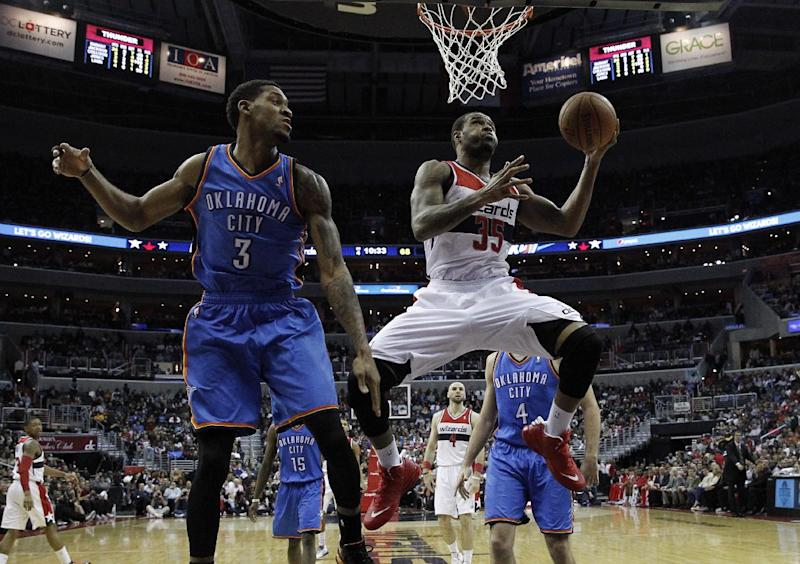 Washington Wizards forward Trevor Booker (35) shoots with Oklahoma City Thunder forward Perry Jones (3) nearby n the second half of an NBA basketball game on Saturday, Feb. 1, 2014, in Washington. The Wizards won 96-81. (AP Photo/Alex Brandon)