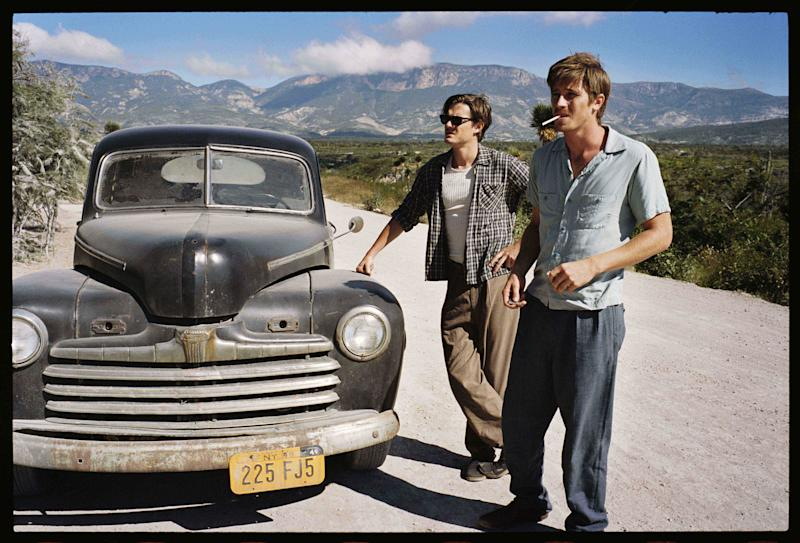 """This undated publicity film image released by IFC Films/Sundance Selects shows Sam Riley, left, as Sal Paradise/Jack Kerouac and Garrett Hedlund, right, as Dean Moriarity/Neal Cassady in a scene from the film, """"On the Road,"""" directed by Walter Salles. (AP Photo/IFC Films/Sundance Selects, Gregory Smith)"""