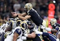 <p>New Orleans Saints quarterback Drew Brees (9) dives for a short touchdown in the second quarter against the Los Angeles Rams at the Mercedes-Benz Superdome. Mandatory Credit: Chuck Cook-USA TODAY Sports </p>