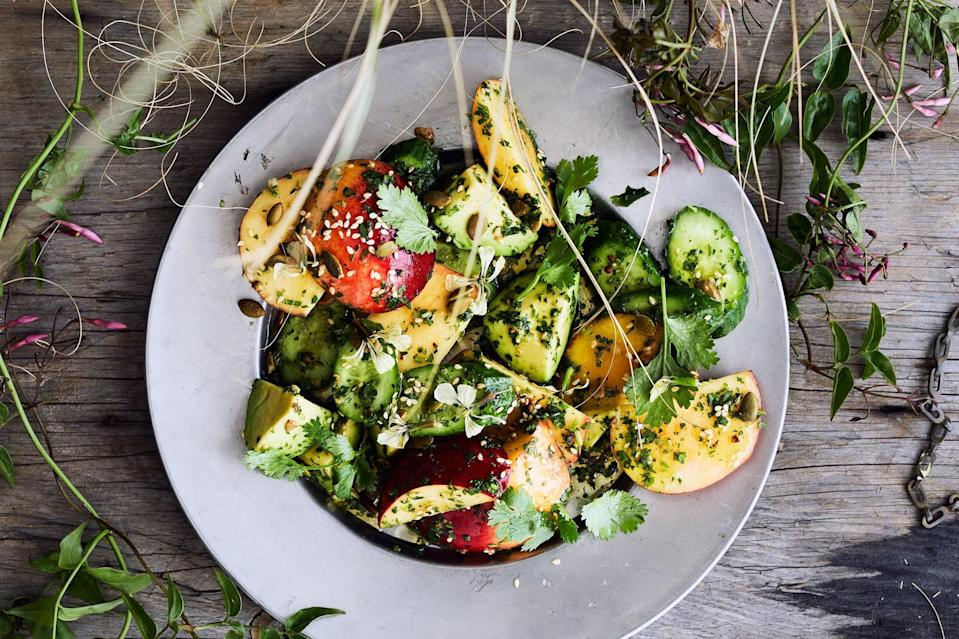"""The intriguing combination of fruits in this summery salad—juicy peaches, crunchy cukes, and buttery avocado—is brought together with a dressing that combines the warm flavors of cardamom and clove with the heat of a serrano chile. <a href=""""https://www.epicurious.com/recipes/food/views/savory-peach-and-cucumber-salad?mbid=synd_yahoo_rss"""" rel=""""nofollow noopener"""" target=""""_blank"""" data-ylk=""""slk:See recipe."""" class=""""link rapid-noclick-resp"""">See recipe.</a>"""