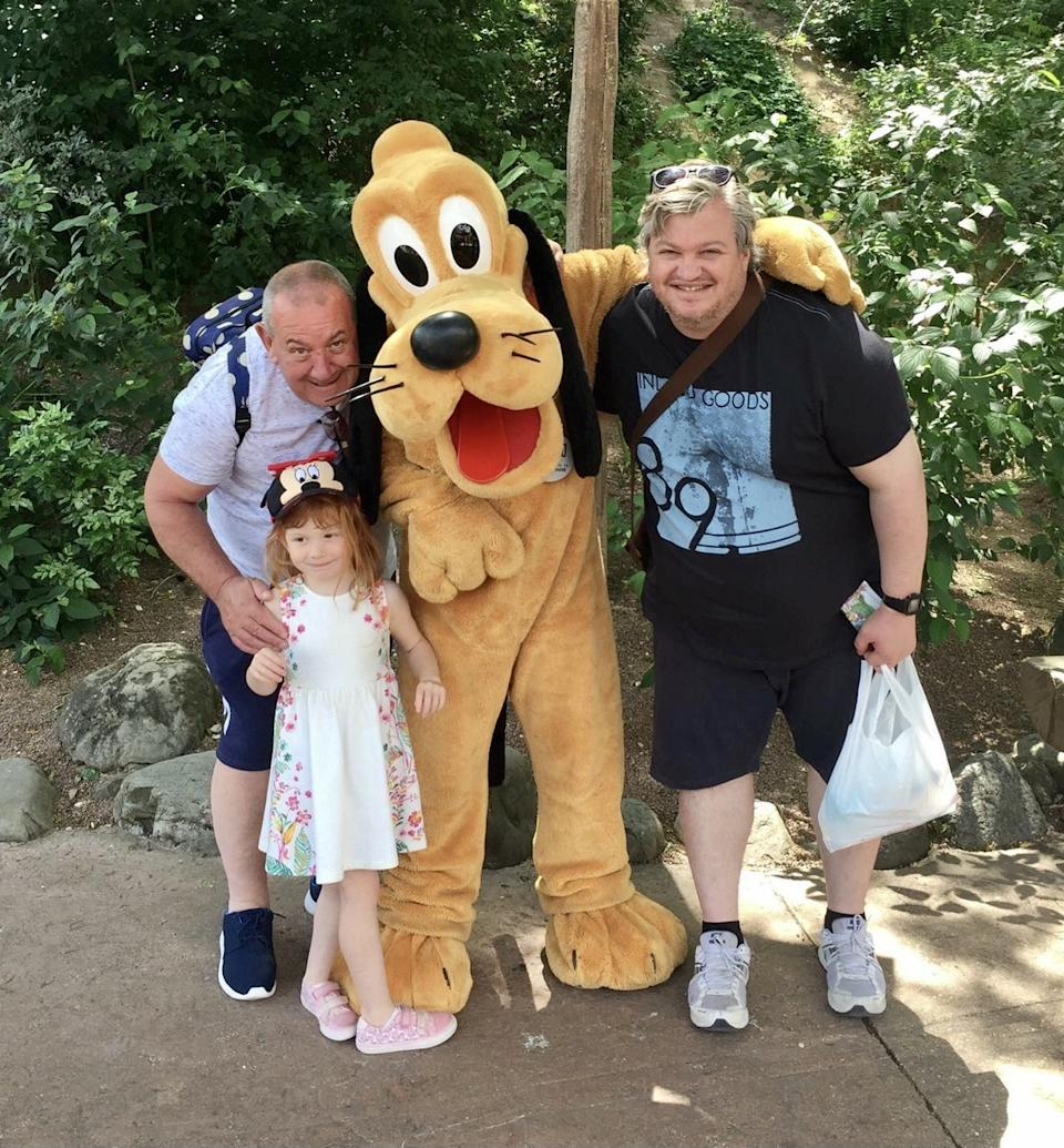 Martin Hannis with his niece at Disneyland in 2017. (SWNS)