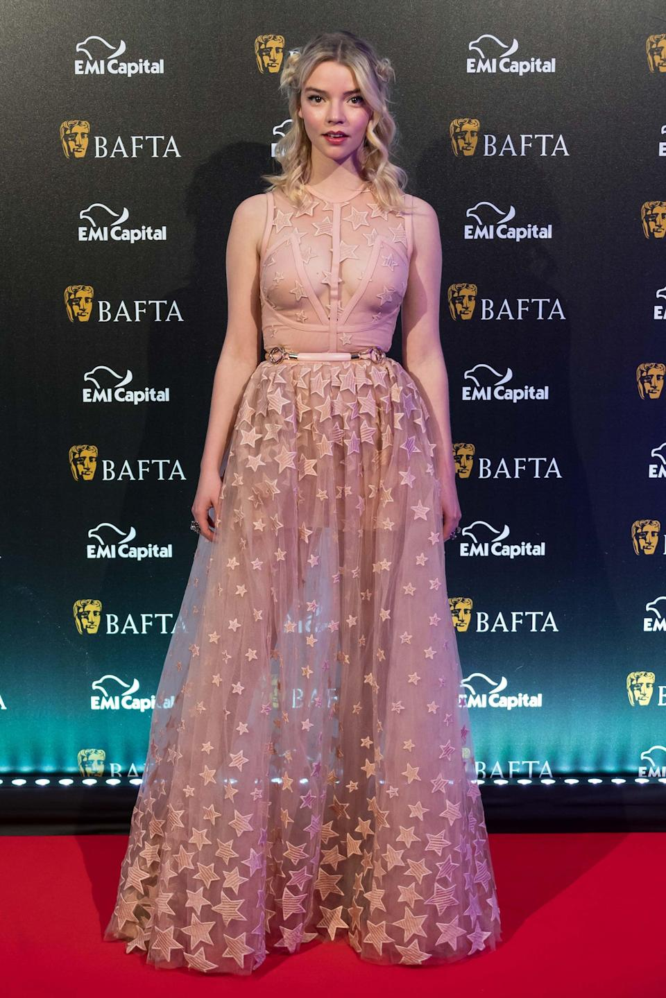 <p>Anya wore a sheer Elie Saab gown covered in stars.</p>