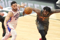 Philadelphia 76ers' Ben Simmons, left, and Chicago Bulls' Al-Farouq Aminu, right, keep their eyes on a loose ball during the first half of an NBA basketball game Monday, May 3, 2021, in Chicago. (AP Photo/Charles Rex Arbogast)
